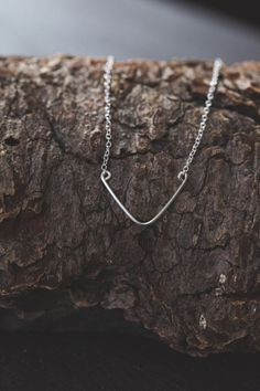 The Baby Blair is a smaller version of our popular Blair necklace. Designed to sit elegantly below your collarbone, this hand forged square wire chevron on a simple chain will quickly become your go-to necklace.