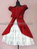 This is just plain cute. I love the sleeves and the brick red and the bow.