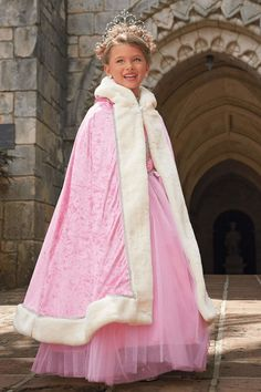 For your little princess, a dream-come-true hooded cape made of pink velour with white faux fur trim. Perfect for playtime & dress up!