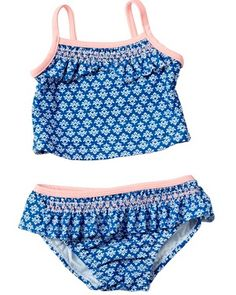 With adorable smocking on its top and bottom, this 2 pc. tankini will make a cute addition to her summer swimwear.