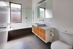 tiles, glass panel over shower stall