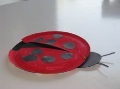 lady bug craft for party---using paper plates--red and black--they state tempera paint--, construction paper and a brad---IMG_3645
