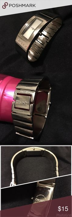 DKNY Bracelet Watch DKNY Bracelet Watch is half bracelet half link; good condition; few scratch but normal wear; Dark neutral grey watch face without any symbols or numbers; Case: Stainless steel, rectangular; Movement: Japanese quartz DKNY Accessories Watches