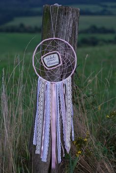 Catch your dreams. Pink-white dream catcher.