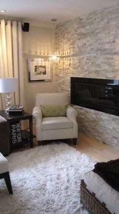 Living Rooms Design - love the stone wall!
