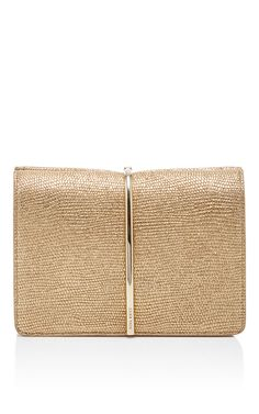 This season Guillaume Henry adds a casual masculinity to the French house's famed femininity, coupled with an ethereal sense of lightness.This **Nina Ricci** bag exudes elegance in gold Lurex-shot jute, calf leather, and lizard.