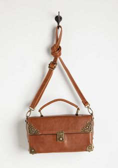 Scrapbook Ending Bag in Cognac. Your day of memory making with this light brown crossbody bag concludes with plans to continue tomorrow! #brown #modcloth