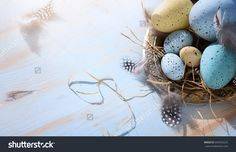 Happy Easter day; Holidays background with Easter eggs on blue table.