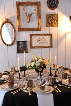 This gold and black decor is ridiculously good! Loving the crochet overlay, black candle holders, gold flatware and the eclectic gold frames #cedarwoodweddings Elegant Black and Gold Cedarwood Wedding | Cedarwood Weddings