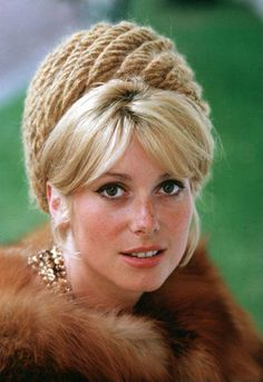 Catherine Deneuve, so chic.  Also here she looks like Lady Diana.