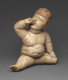 """""""Baby Figure,"""" 12th–9th century B.C.  Mexico; Olmec  Ceramic, cinnabar, red ocher"""