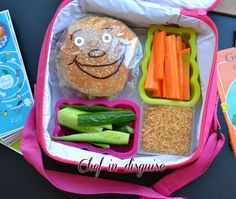 Lunch box with smiling sandwiches