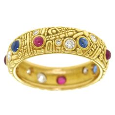 Alex Sepkus Carved Collection Ruby Sapphire Diamond Gold Ring | From a unique collection of vintage band rings at https://www.1stdibs.com/jewelry/rings/band-rings/