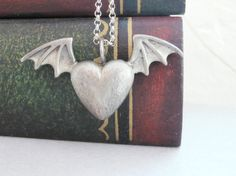 Angel Devil Heart necklace Heart with bat wings by FoxInTheBox