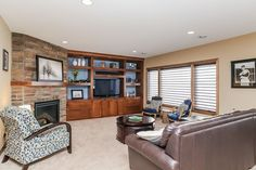 I simply love the cozy corner gas fireplace and huge windows in this 5300 sq ft home in Credit River!  My fav feature of the basement rec room, however, is the accent paint behind the custom built ins.  $750,000 6625 Oak Grove Court Credit River Twp MN 55372 Prior Lake Schools MLS #4739441 www.melissajohnsonrealestate.com