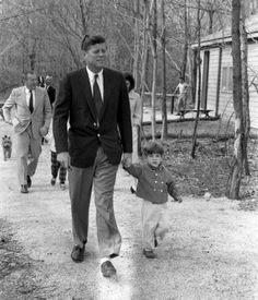 JFK and JFK Jr. at Camp David in Maryland.  Jackie is in the background (March 31, 1963