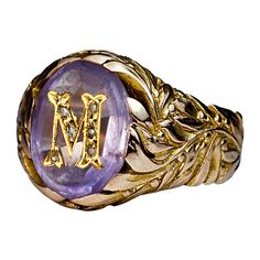 Antique Russian Monogrammed Amethyst Gold Mens Ring c. 1908  Russia  c. 1908  This finely modeled and well crafted vintage Russian gold ring was made in Moscow between 1908 and 1917.    The pale purple oval amethyst is inlaid with a gold monogram 'M', embellished with six tiny rose cut diamonds.