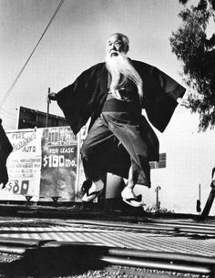Ralph Crane - In Los Angeles, 78 year old Shichizo Takeda, a Japanese movie extra, enjoys working out on a trampoline, 1960. S)