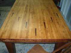 Dining table made from repurposed bowling lane arrow marker section. Bowled over by hinz57 on Facebook