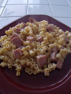 Ham and Cheese Macaroni: 1 1/2 cups uncooked macaroni, 1/4 c. butter, 1/4 c. flour, 1 3/4 c. milk, 8 ounces cheese cut into chunks, 1-2 c. left over ham cut into chunks. Prepare macaroni. Melt butter; add flour over low heat, stir constantly until smooth and bubbly; remove from heat. Stir in milk; heat to boiling, stir constantly. Boil and stir 1 minute, remove from heat. Stir in cheese until melted. Place macaroni in ungreased casserole. Stir sauce over macaroni. Bake at 375 for 30 min.