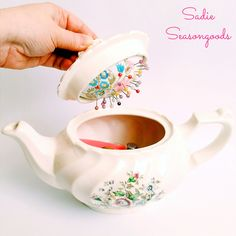 this hidden pincushion inside a teapot is brilliant, you can store all the little sewing bits inside as well
