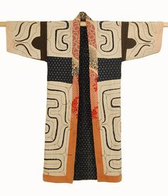 Ainu Robe (chikarkarpe) - They function as protective shield not only from nature and weather but also to prevent evil spirits from entering the body. Originally isolated from the world Ainu wove their cloth from fiber derived of tree bark. Cotton , traded from the Japanese was greatly cherished and used as decorative accents. In the second half of the 19th century as cotton became more available it was more widely used.