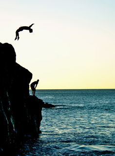 Cliff jumping. I'm most concerned about the fact that he may hit his head off the rock.