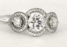 Round diamond engagement ring three stone