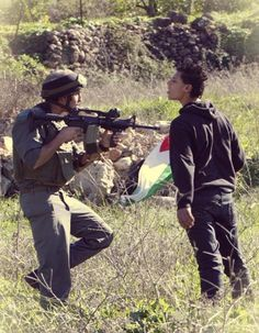 intense--Palestinian youth standing up to Israeli soldier