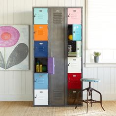 """VINTAGE STEEL COLORBLOCK LOCKER--Reclaimed from decades of use in schools and factories, solid American steel is refurbished with bright powder-coat colors for a fresh new life in your family room, child's room, mudroom and more. A dozen small lockers, each a different color, and one full-length locker provide ample and varied storage. Made in the USA exclusively for Sundance. 36""""W x 12""""D x 72""""H."""