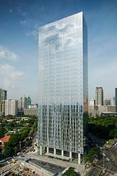 Environmental Elegance Located in Manila's Central Business District, the Zuellig Building is notable for its environmentally conscious design and distinctive facade. The skyscraper, which is LEED® Platinum certified, utilizes a frit pattern to minimize solar gain and energy loss on each floor. Printed onto the glass curtain wall, the signature fritting was designed to reference local organic motifs and reinforce the tower's vertical proportions. A wooden, monumental structure in ...