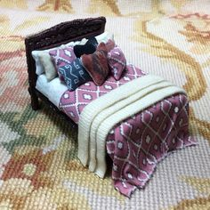 "Pat Tyler Artist Made OOAK 1/2"" Dressed bed. The frame is made of wood and resin, and measures approximately 2 3/4"" Wide, 2 1/4"" High, 3 1/2"" Deep. I have embellished and dressed in various patterns a"