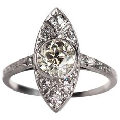 For Sale on - Beautiful navette shape ring with hand carved design on the shank Item Details: Ring Size: Metal Type: Platinum Weight: grams Center Diamond Details 1920s Engagement Ring, Perfect Engagement Ring, Antique Rings, Vintage Rings, Vintage Jewellery, Jewellery Box, Vintage Style, Jewelry Rings, 10 Carat Diamond Ring