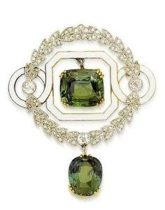 An early 20th century alexandrite, enamel and diamond brooch, circa 1905. Of circular form, the central cushion-shaped alexandrite drop within a triple four-claw setting, suspended from a white enamel octagonal frame with circular shoulders, encircled by an old brilliant and rose-cut diamond laurel-leaf wreath surround, terminating in a second cushion-shaped alexandrite drop within a triple three-claw setting, mounted in platinum and gold, length 4.5cm. #Edwardian #antique #brooch by…