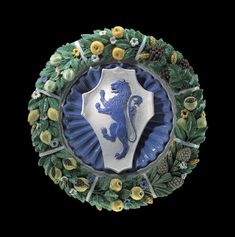 A POLYCHROME GLAZED CIRCULAR TERRACOTTA RELIEF WITH THE ARMS OF THE ACCIAIUOLI FAMILY WORKSHOP OF GIOVANNI DELLA ROBBIA (FLORENCE 1469-1529/30), FLORENCE, PROBABLY EARLY-16TH CENTURY
