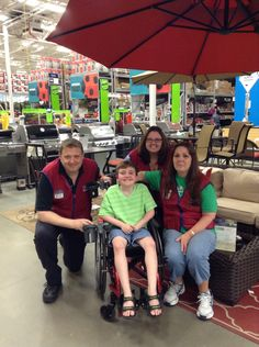 This is Anthony's March 17th visit to the Winter Garden Lowes to thank them for their fundraising work for Muscular Dystrophy.  Michael, the manager took Anthony around the store in his wheelchair, Erin helped him feed the fish and turtles in their garden department and Melanie is the cashier who has brought in the most money for the MDA (she cried when she saw Anthony because she has such a kind heart).