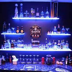 Use our led back bar shelves in your restaurant, bar or lounge to boost the visibility of your highest margin liquor. Our shelves are also eye-catching which makes them great for display products of all sorts! Regal Display, Floating Glass Shelves, Glass Bar Shelves, Floating Wall, Bar Led, Home Bar Designs, Back Bar, Man Cave Home Bar, Man Cave Bar Wall Ideas