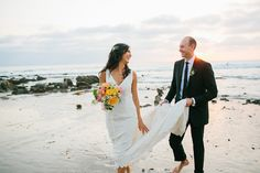 We love a classic beach wedding filled with love.  Lindsey & Michael's love story begins When a girl from Orange County hit the Big Apple, Lindsey probably wasn't expecting to fall in love with a boy from New Zealand. And what better location to get married but on the California coast, half way between New Zealand and New York, bringing together their world-wide loved ones. Every detail is dreamy and this beauty captured by Cami Jane Photography.  Gown by Sarah Jassir.