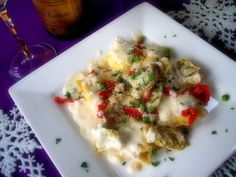 Ravioli with Artichokes, Sun Dried Tomatoes and Peas in a Cream Sauce