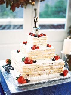 New Orleans wedding, Italian wedding cake, fruit, Mille feuille wedding cake by Royal Cakery, platform by event rental, topper is the bride's grandparent's topper from 1949, cake pulls, wedding film photography, image by Reg Campbell
