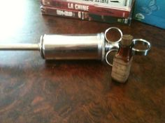 Large antique syringe, chocolate-covered mercury tablets.  Quack medicine of the worst kind since mercury is poisonous.  :)