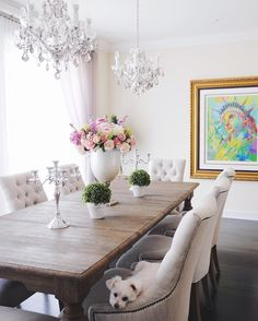 Dining room decor | 2 double chandeliers light fixtures | Restoration Hardware dining table and chairs | statement art | statement floral arrangement | Classy Glam Living