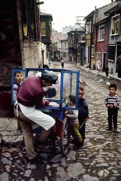 Cotton candy vendor in the district of Zeyrek, Istanbul, 1970.  [Credit : Ara Güler]