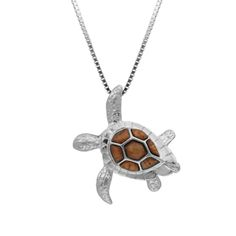 """Koa Wood Turtle Pendant Sterling silver sea turtle pendant with koa wood inlay. 3-D design. 31mm high (approx. 1 1/4"""") measuring from top to bottom fin. 18"""" box chain included."""