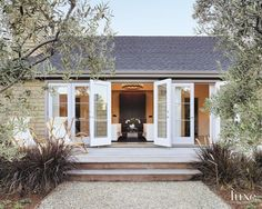 This home connects to the outdoors with French doors attached to all of its main spaces, allowing them to spill onto a large deck.