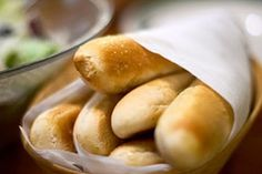 Olive Garden Breadsticks -  For the Breadstick Dough: 1.5 cups warm water 1 package active dry yeast OR 2 1/4 teaspoons bread machine yeast 4 1/4 bread flour (use all purpose if it's not available) 2 tablespoons unsalted butter, melted 2 tablespoons sugar 1 tablespoon salt  For the topping: 1 stick unsalted butter, melted 2 teaspoons garlic powder 1 teaspoons salt