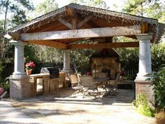 A DIY Project By HGTV Fan This Covered Pavilion Features A Flagstone Patio  Surface, Outdoor Kitchen And Wood Or Gas Fireplace.