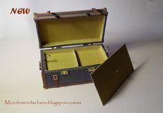 Nuevo baúl de viaje, en miniatura, de diseño.