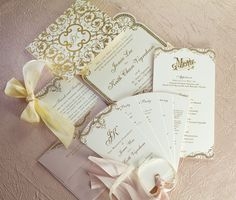 East Six's cream and blush stationery suite with gold foil combines Old World glamour with luxurious details.