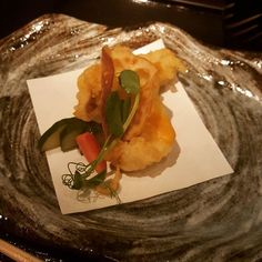 the seventh #kaiseki course is also called mushimono (steamed/fried): fried green spotted rock fish from santa barbara with uni butter and fried lotus root  #rockfish #unibutter #lotusroot #seafood #mushimono #nnaka by naanprophet